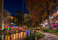 This is an image of the San Antonio riverwalk christmas time.  The restaurants had their christamas decorations up and the trees had colorful christmas lights hanging down and even the river boats had holiday decorations so the mood was very festive.