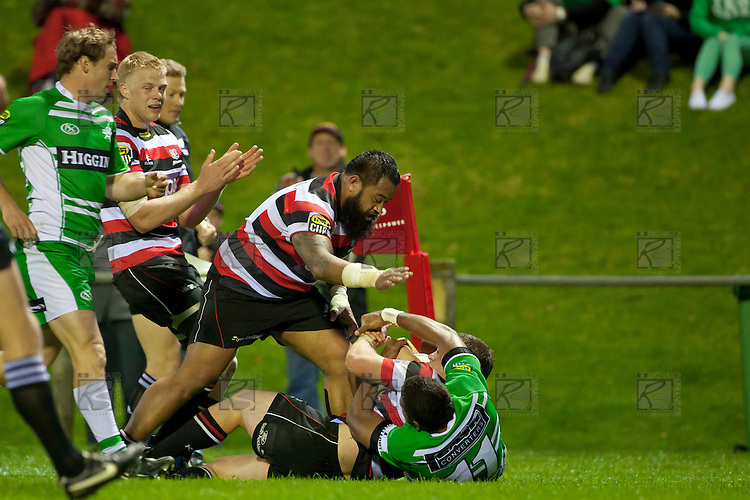 Steelers Baden Kerr & Simon Lemalu arrive to congratulate Mark Selwyn on scoring the second try. ITM Cup rugby game between Counties Manukau and Manawatu played at Bayer Growers Stadium on Saturday August 21st 2010..Counties Manukau won 35 - 14 after leading 14 - 7 at halftime.