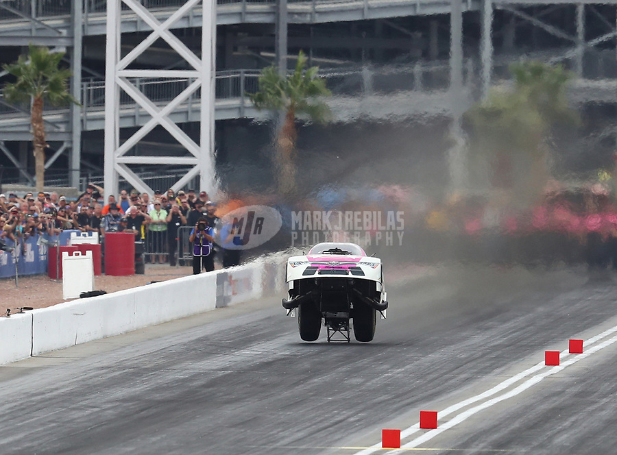 Oct 30, 2016; Las Vegas, NV, USA; NHRA funny car driver Cruz Pedregon does a wheelstand as he wins his round one race during the Toyota Nationals at The Strip at Las Vegas Motor Speedway. Mandatory Credit: Mark J. Rebilas-USA TODAY Sports