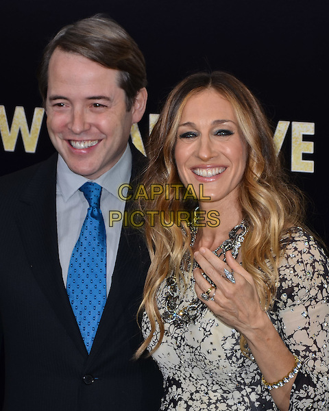 Matthew Broderick & Sarah Jessica Parker.'New Year's Eve' New York premiere, USA..7th December 2011.half length black suit jacket grey gray shirt blue tie white print dress hand rings smiling married husband wife necklace sjp.CAP/ADM/CS.© Chris Smith/AdMedia/Capital Pictures