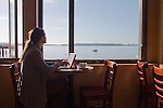 Port Townsend, woman and laptop, morning coffee, waterfront cafe, Better Living Through Coffee, Olympic Peninsula, Washington State, Pacific Northwest, USA,