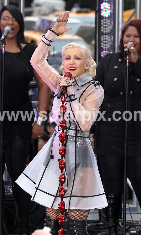 **ALL ROUND PICTURES FROM SOLARPIX.COM**.**SYNDICATION RIGHTS FOR UK, AUSTRALIA, DENMARK, PORTUGAL, S. AFRICA, SPAIN & DUBAI (U.A.E) & ASIA (EXCLUDING JAPAN) ONLY**.Christina Aguilera performing on the The Early Show Summer Concert Series -at the CBS Studio Plaza, New York City, NY, USA. 8 June 2010..This pic: Christina Aguilera..JOB REF: 11449 PHZ Mayer   DATE: 08_06_2010.**MUST CREDIT SOLARPIX.COM OR DOUBLE FEE WILL BE CHARGED**.**MUST NOTIFY SOLARPIX OF ONLINE USAGE**.**CALL US ON: +34 952 811 768 or LOW RATE FROM UK 0844 617 7637**