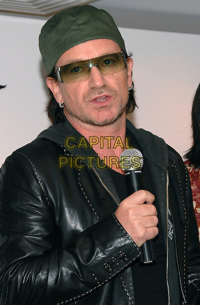 BONO - U2.The launch of his new Edun line of socially conscious clothing at Barney's in New York City..May 22nd, 2005.Photo Credit: Patti Ouderkirk/AdMedia.half length hat sunglasses shades stubble facial hair piercings earrings.www.capitalpictures.com.sales@capitalpictures.com.© Capital Pictures.
