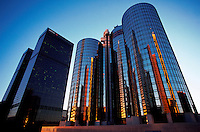 The exterior of the Bonaventure Hotel in late afternoon light with surrounding buildings reflected in its windows. Los Angeles, California.