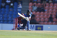 March 1st 2020,Pallekele International Cricket Stadium, Balagolla, Sri Lanka; One Day International cricket, Sri Lanka versus West Indies; Dimuth Karunaratne plays a reverse sweep to make four runs to the boundary