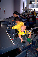 Boy age 5 recovering from cancer playing at Children's Museum.   St Paul  Minnesota USA