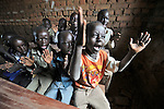 Students sing enthusiastically during class in the Southern Sudanese village of Mankaro. The school was constructed by the United Methodist Committee on Relief (UMCOR).  Families here are rebuilding their lives after returning from refuge in Uganda in 2006 following the 2005 Comprehensive Peace Agreement between the north and south. . NOTE: In July 2011, Southern Sudan became the independent country of South Sudan