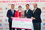 Jung Min Lee of South Korea (second from left) receives her trophy and check from the hands of T.K. Pen (left), Wang Liwei (second from right), and Iain Roberts (right) during the Prize giving ceremony of the World Ladies Championship 2016 on 13 March 2016 at Mission Hills Olazabal Golf Course in Dongguan, China. Photo by Victor Fraile / Power Sport Images