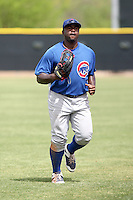 Michael Burgess #25 of the Chicago Cubs plays in a minor league spring training game against the Los Angeles Angels at the Angels complex on April 2, 2011  in Tempe, Arizona. .Photo by:  Bill Mitchell/Four Seam Images.