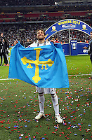 Pictured: Michu with a flag celebrating after the final whistle.  Sunday 24 February 2013<br /> Re: Capital One Cup football final, Swansea v Bradford at the Wembley Stadium in London.