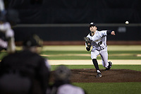 Wake Forest Demon Deacons relief pitcher Tyler Witt (12) delivers a pitch to the plate against the Louisville Cardinals at David F. Couch Ballpark on March 6, 2020 in  Winston-Salem, North Carolina. The Cardinals defeated the Demon Deacons 4-1. (Brian Westerholt/Four Seam Images)