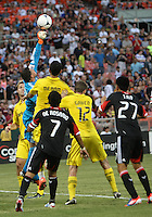 WASHINGTON, DC - AUGUST 4, 2012:  Dwayne DeRosario (7) and Long Tan (27) of DC United watch Andy Gruenebaum (30) of the Columbus Crew punch clear during an MLS match at RFK Stadium in Washington DC on August 4. United won 1-0.