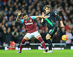 West Ham's Mauro Zarate tussles with Stoke's Philipp Wollscheid<br /> <br /> Barclays Premier League - West Ham United v Stoke City - Upton Park - England -12th December 2015 - Picture David Klein/Sportimage