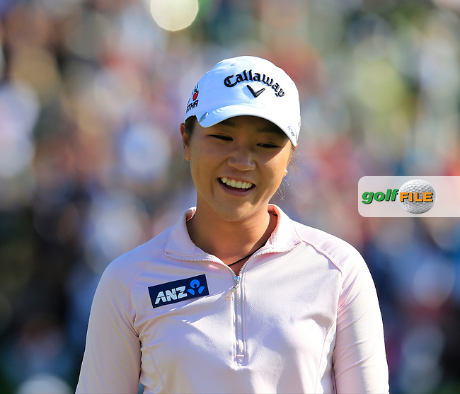 Lydia Ko (NZL) walks onto the 18th green with a 6 shot lead during Sunday's Final Round of the LPGA 2015 Evian Championship, held at the Evian Resort Golf Club, Evian les Bains, France. 13th September 2015.<br /> Picture Eoin Clarke   Golffile