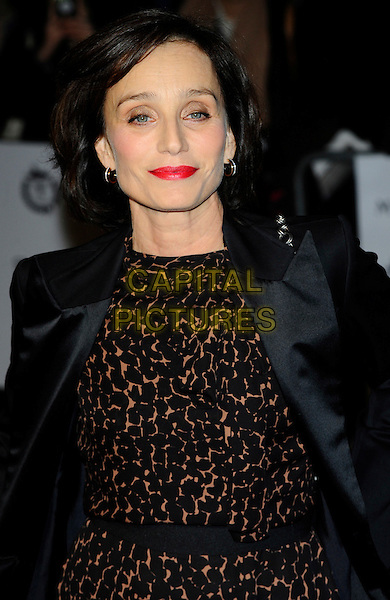 KRISTIN SCOTT THOMAS.The London Critics' Circle Film Awards held at the BFI Southbank - Arrivals. London, England..February 10th, 2011.ALFS half length black dress brown leopard blazer jacket red lipstick  print .CAP/CJ.©Chris Joseph/Capital Pictures.
