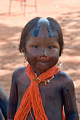 Pará State, Brazil. Aldeia A-Ukre (Kayapó). Child with traditional body and hair dcoration.