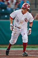 Caleb Bushyhead (5) heads to first base after being walked during the NCAA matchup between the University of Arkansas-Little Rock Trojans and the University of Oklahoma Sooners at L. Dale Mitchell Park in Norman, Oklahoma; March 11th, 2011.  Oklahoma won 11-3.  Photo by William Purnell/Four Seam Images
