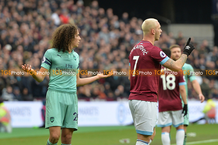 Matteo Guendouzi of Arsenal and Marko Arnautovic of West Ham United during West Ham United vs Arsenal, Premier League Football at The London Stadium on 12th January 2019