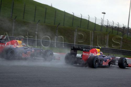 25.03.2012. Kuala Lumpur, Malaysia.  Formula 1 GP Malaysia in Kuala Lumpur Sebastian Vettel and Mark Webber Red Bull Racing motor racing in the spray of the rain