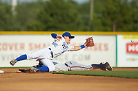 Michael Massey (6) of the Burlington Royals reaches for a throw as Cody Milligan (7) of the Danville Braves slides head first into second base at Burlington Athletic Stadium on July 13, 2019 in Burlington, North Carolina. The Royals defeated the Braves 5-2. (Brian Westerholt/Four Seam Images)