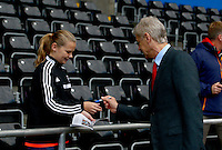Arsenal manager Arsene Wenger signs autographs as he arrives before the Barclays Premier League match between Swansea City and Arsenal played at The Emirates Stadium, London on October 4th 2015
