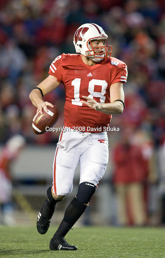 MADISON, WI - NOVEMBER 22: Quarterback Dustin Sherer #18 of the Wisconsin Badgers throws a pass against the Cal Poly Mustangs at Camp Randall Stadium on November 22, 2008 in Madison, Wisconsin. Wisconsin beat Cal Poly 36-35 in overtime. (Photo by David Stluka)