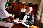 Michael Gisick signs the wedding registry after his marriage to Megan Bainbridge in Queenscliff, Australia. Nov. 16, 2012.