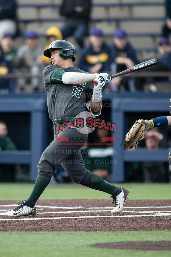 Michigan State Spartans second baseman Royce Ando (13) swings the bat in the NCAA baseball game against the Michigan Wolverines on May 7, 2019 at Ray Fisher Stadium in Ann Arbor, Michigan. Michigan defeated Michigan State 7-0. (Andrew Woolley/Four Seam Images)
