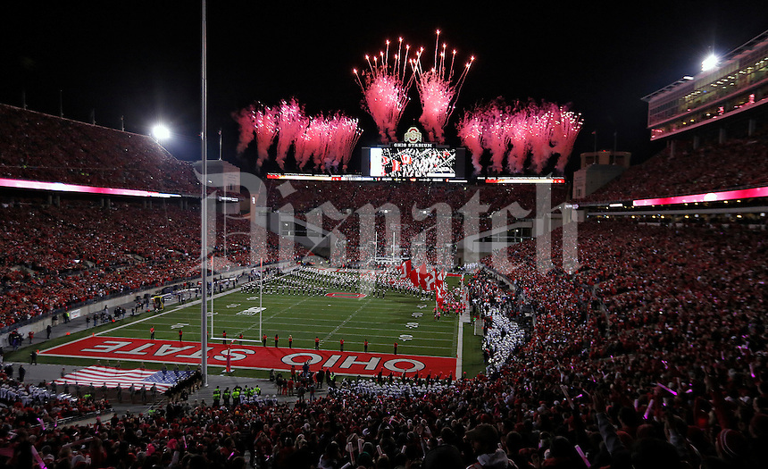 Ohio State Buckeyes teams runs onto the field for their game against Penn State Nittany Lions at Ohio Stadium on October 26, 2013.  (Dispatch photo by Kyle Robertson)