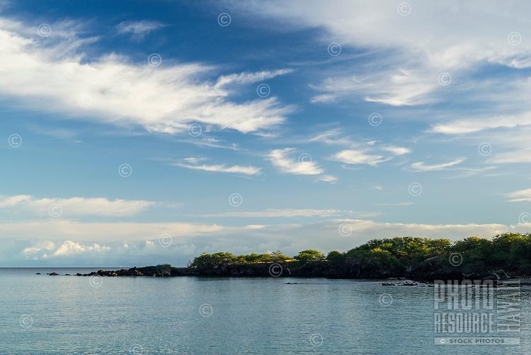 Varied cloud formations and morning light at Waialea Bay, Kohala Coast, Big Island.