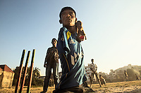 Mohammad Sharif bowls during a cricket practice match in Chittagong, Bangladesh.