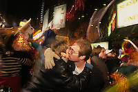 (011211-SWR04.jpg) New York, NY - A man and woman kiss amid the frenzied crowd of Tourists and New Yorkers on the first night,  to welcome in the New Year in Times Square, NYC. <br /> &copy; STACY WALSH  ROSENSTOCK