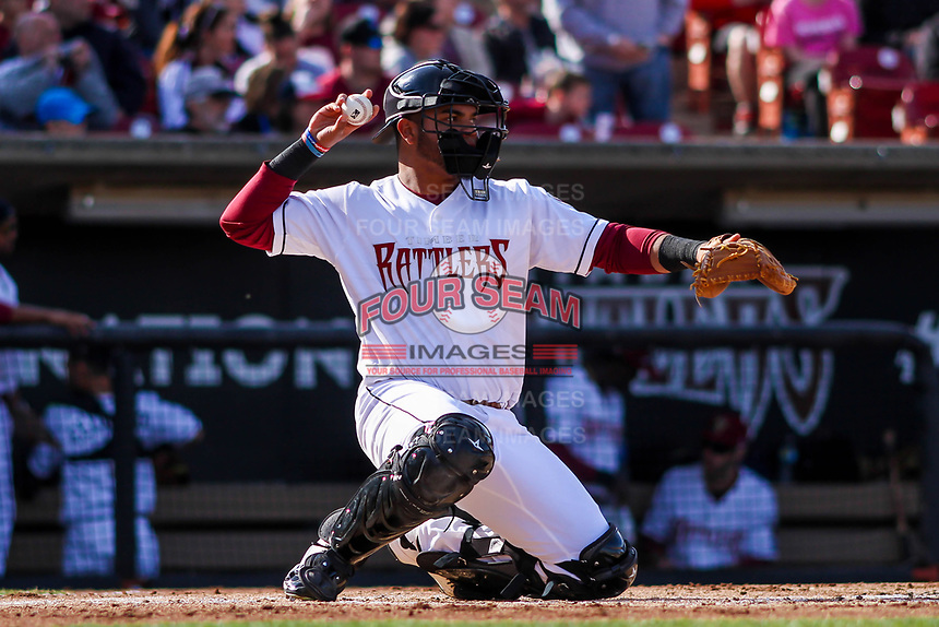 Wisconsin Timber Rattlers catcher Yoel Vasquez (23) during a Midwest League game against the Quad Cities River Bandits on April 8, 2017 at Fox Cities Stadium in Appleton, Wisconsin.  Wisconsin defeated Quad Cities 3-2. (Brad Krause/Four Seam Images)