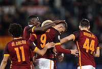Calcio, Serie A:  Roma vs Palermo. Roma, stadio Olimpico, 21 febbraio 2016. <br /> Roma's Edin Dzeko, second from right, is hugged by teammates after scoring during the Italian Serie A football match between Roma and Palermo at Rome's Olympic stadium, 21 February 2016.<br /> UPDATE IMAGES PRESS/Riccardo De Luca