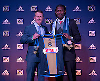 #1 overall pick Andre Blake of the Philadelphia Union stands with head coach John Hackworth during the MLS SuperDraft at the Pennsylvania Convention Center in Philadelphia, PA, on January 16, 2014.