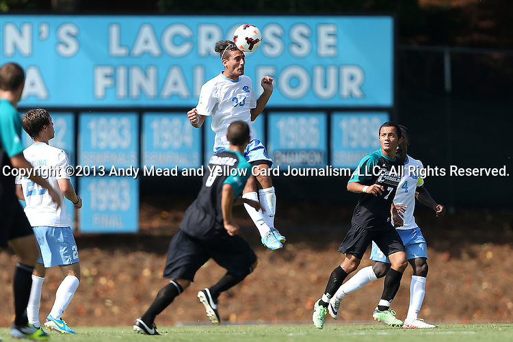 02 September 2013: North Carolina's Raby George (SWE) (33) heads the ball over Coastal Carolina's Ricky Garbanzo (7) and Justin Portillo (8). The University of North Carolina Tar Heels hosted the Coastal Carolina University Chanticleers at Fetzer Field in Chapel Hill, NC in a 2013 NCAA Division I Men's Soccer match. UNC won the game 4-0.