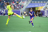 Orlando, Florida - Sunday, May 8, 2016: Orlando Pride defender Stephanie Catley (7) has her service blocked by Seattle Reign FC midfielder Lindsay Elston (6) during a National Women's Soccer League match between Orlando Pride and Seattle Reign FC at Camping World Stadium.