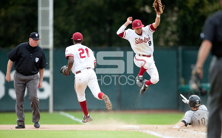 STANFORD, CA - March 27, 2011: Brian Ragira of Stanford baseball forces the batter out at first while Lonnie Kauppila avoids the collision while covering the bag during Stanford's game against Long Beach State at Sunken Diamond. Stanford won 6-5.