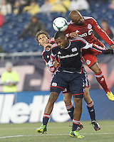 New England Revolution midfielder Scott Caldwell (6), New England Revolution defender Andrew Farrell (2) and Toronto FC defender Robert Earnshaw (10) battle for a crossed ball. In a Major League Soccer (MLS) match, the New England Revolution (blue) defeated Toronto FC (red), 2-0, at Gillette Stadium on May 25, 2013.