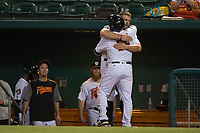 Fresno Grizzlies first baseman AJ Reed (18) congratulates Tim Federowicz (26) after scoring a run during a Pacific Coast League game against the Salt Lake Bees at Chukchansi Park on May 14, 2018 in Fresno, California. Fresno defeated Salt Lake 4-3. (Zachary Lucy/Four Seam Images)