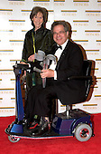 "Itzhak Perlman and his wife, Toby, arrive at the Harry S. Truman Building (Department of State) in Washington, D.C. on December 4, 2004 for a dinner hosted by United States Secretary of State Colin Powell.  At the dinner six performing arts legends will receive the Kennedy Center Honors of 2004.  This is the 27th year that the honors have been bestowed on ""extraordinary individuals whose unique and abundant artistry has contributed significantly to the cultural life of our nation and the world"" said John F. Kennedy Center for the Performing Arts Chairman Stephen A. Schwarzman.  The award recipients are: actor, director, producer, and writer Warren Beatty; husband-and-wife actors, writers and producers Ossie Davis and Ruby Dee; singer and composer Elton John; soprano Joan Sutherland; and composer and conductor John Williams..Credit: Ron Sachs / CNP"