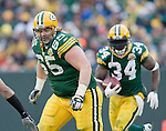Offensive lineman Mark Tauscher #65 of the Green Bay Packers leads the way for running back Vernand Morency #34 during an NFL football game against the Oakland Raiders at Lambeau Field on December 9, 2007 in Green Bay, Wisconsin. The Packers beat the Raiders 38-7. (Photo by David Stluka)