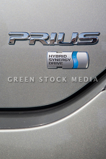 Close-up of Gray Toyota Prius with Hybrid Synergy Drive tag. California, USA