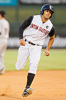 Keenyn Walker #2 of the Kannapolis Intimidators hustles towards third base against the Delmarva Shorebirds at Fieldcrest Cannon Stadium on August 6, 2011 in Kannapolis, North Carolina.  The Intimidators defeated the Shorebirds 14-6.   (Brian Westerholt / Four Seam Images)