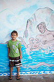 FRENCH POLYNESIA, Moorea. Dushan in front of Mural.