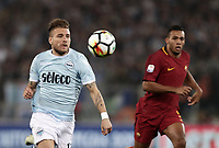 Calcio, Serie A: S.S. Lazio - A.S. Roma, stadio Olimpico, Roma, 15 aprile 2018. <br /> Lazio's Ciro Immobile (l) in action with Roma's Juan Jesus (r) during the Italian Serie A football match between S.S. Lazio and A.S. Roma at Rome's Olympic stadium, Rome on April 15, 2018.<br /> UPDATE IMAGES PRESS/Isabella Bonotto