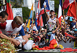 KAILUA-KONA, HI - OCTOBER 13:  Frederick Van Lierde of Belgium crosses the finish line for a third place as Andreas Raelert of Germany crosses the finish line for a second place and collapses during the 2012 IRONMAN World Championships on October 13, 2012 in Kailua-Kona, Hawaii. (Photo by Donald Miralle)