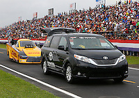 Apr 24, 2015; Baytown, TX, USA; NHRA  funny car driver Del Worsham being towed past the grandstands on the return road by their Toyota tow vehicle during qualifying for the Spring Nationals at Royal Purple Raceway. Mandatory Credit: Mark J. Rebilas-