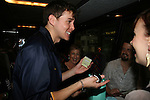 Daniel Kennedy receiving a gift on AMC Bus Trip Around Manhattan held on September 12, 2009 from the upper east side to Battery Park, Ground Zero and all around Manhattan. (Photo by Sue Coflin/Max Photos)