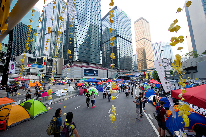 HONG KONG, HONG KONG SAR, CHINA - OCTOBER 13: Yellow paper umbrellas hang from a bridge in the 'Occupy Central' camp on Connaught road, Admirality, Hong Kong, China, on October 13, 2014. Hundreds of men attempted to break through barricades erected by Hong Kong pro-democracy protesters near the city's business district, as a third week of rallies tried the patience of truck and cab drivers. 'Occupy Central' protesters rebuilt barricades to make sure Queensway stayed theirs. The 'Umbrella revolution' or 'Occupy Central' is a civil disobedience movement that began in response to China's decision to allow only Beijing-vetted candidates to stand in the city's 2017 election for the top civil position of chief executive. Thousands of pro-democracy supporters are calling for open elections and the resignation of Hong Kong's Chief Executive Leung Chun-ying. (Photo by Lucas Schifres/Getty Images)